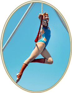 Photo of woman hanging on trapeze