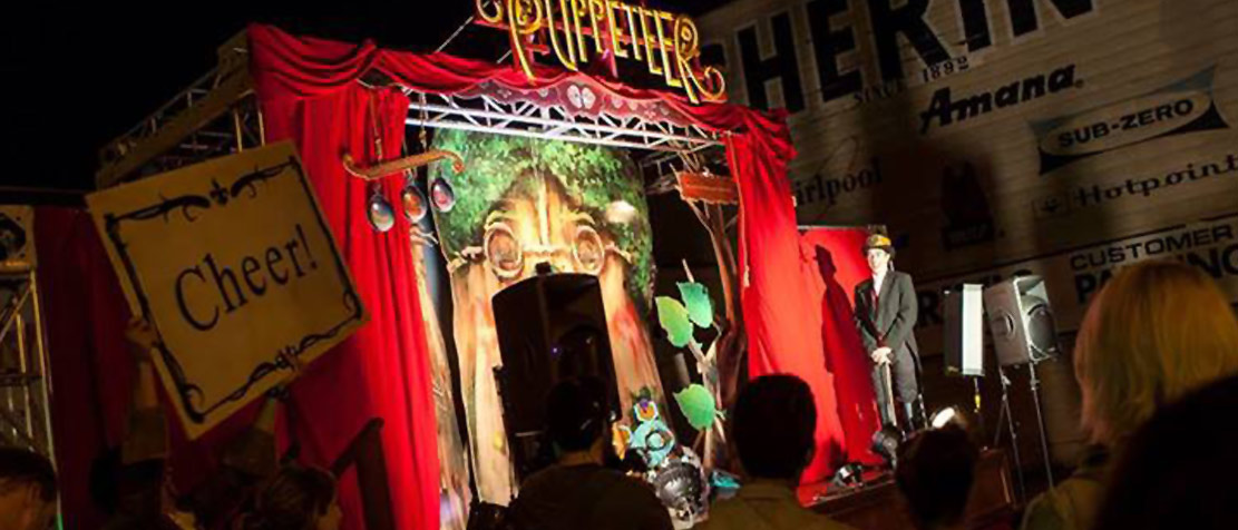 Photo of the night-time stage performance for The Puppeteer