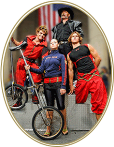 Photo of group holding unicycles